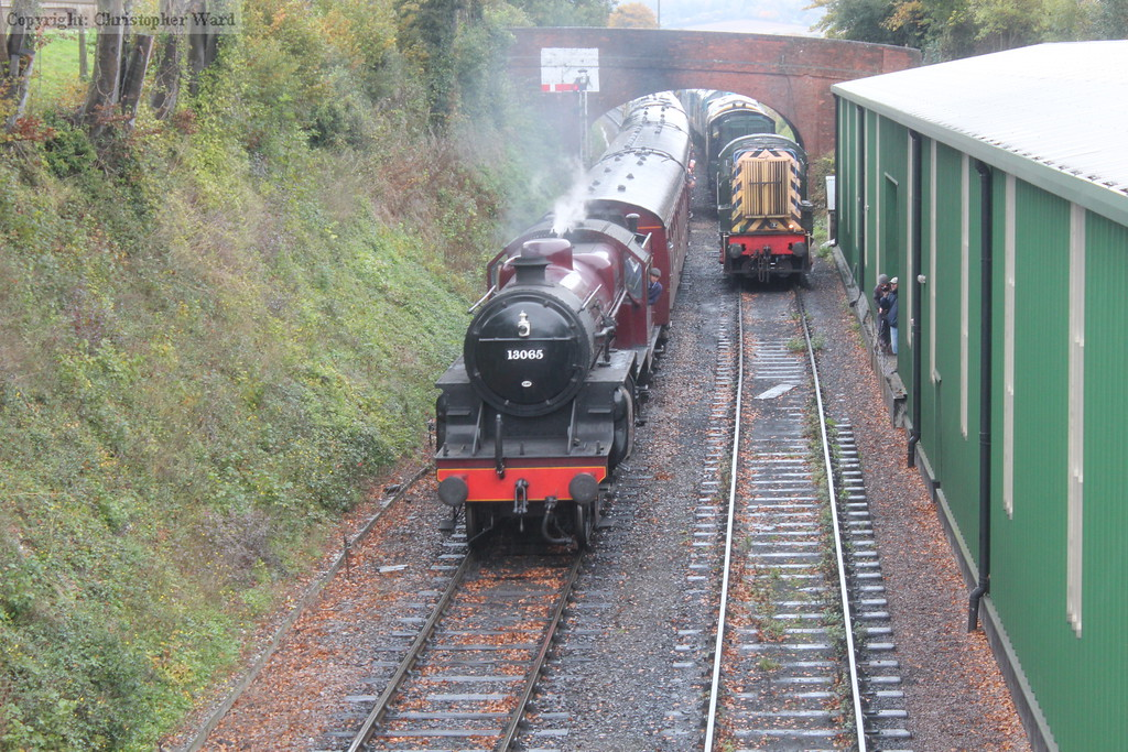 13065 descends into Ropley in heavy drizzle