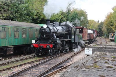 The Ivatt splits off the miscellaneous freight wagons from the vans for a run to Ropley