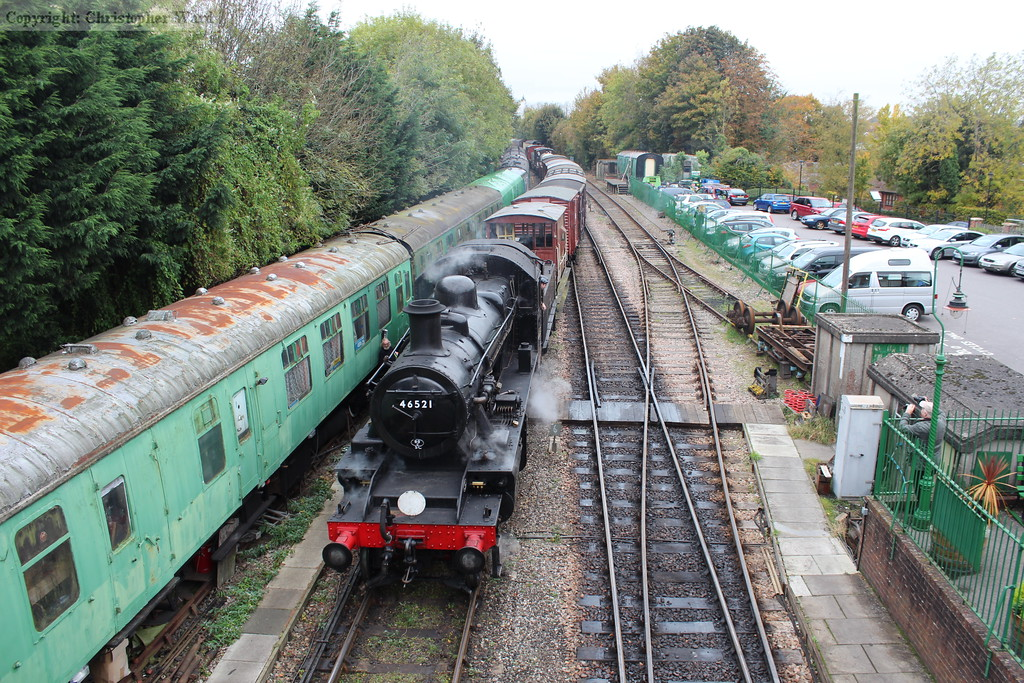 The long freight is pushed back into the sidings by 46521