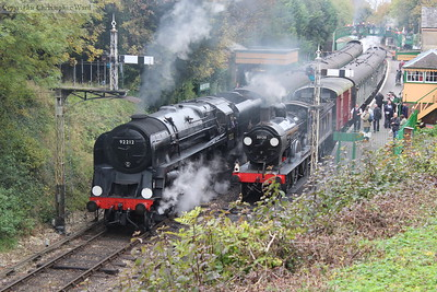 The T9 tails the local train into the station as the 9F prepares to depart