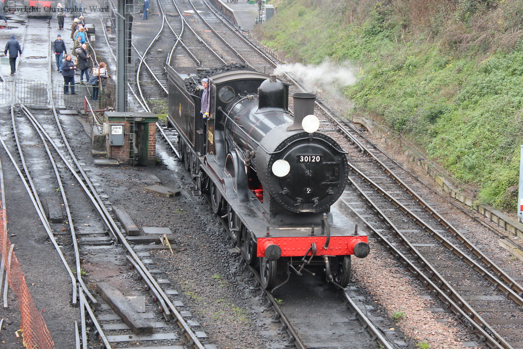 A wisp of steam from the valves as the LSWR veteran drops back to allow the vans to be shunted