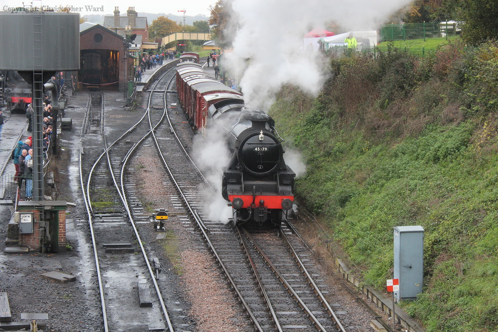 The Black Five gets to grips with her freight at a damp Ropley