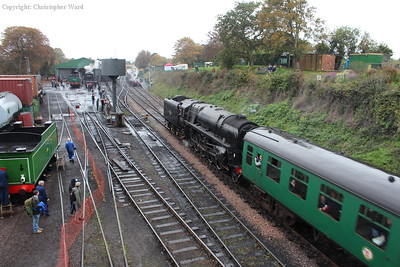 The 9F slows for the station stop