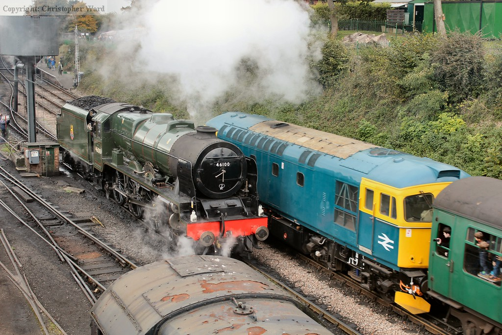 Royal Scot and her Thunderbird with the LMS beast preparing to rejoin her train