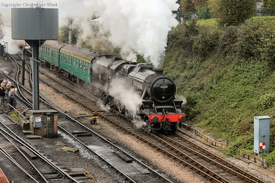 The Black Five gets away from Ropley with an Alton train