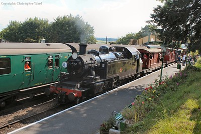 An LCGB brake van special re-enactment arrives at Ropley