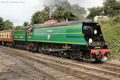 34081 makes an impressive sight as she pulls away with an Alton train