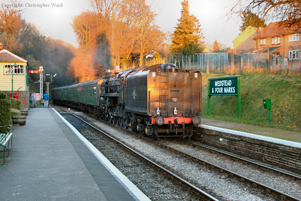 92212 in the early evening sunshine arrives from Alton