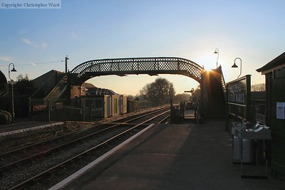 The sun starts to set behind the footbridge at Medstead