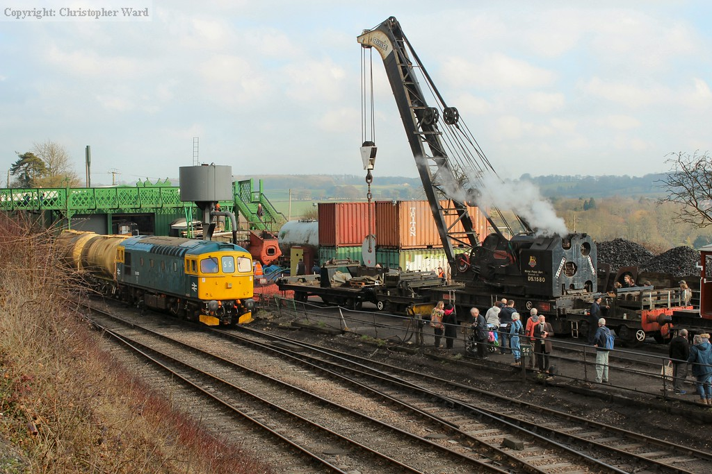 33053 with two tank wagons alongside the impressive steam crane performing lifting demonstrations in the yard