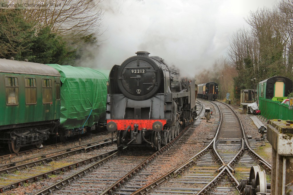 The 9F brings a brake van out of the yard while shunting