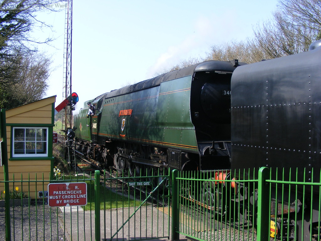 34007 pilots the 9F on an Alresford train