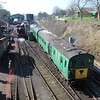 The DEMU runs into the headshunt while the Met tank waters