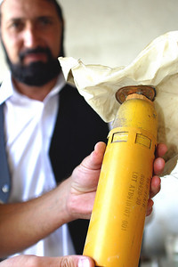 One morning Nasrullah and his cousin, Nabile, were running late for school. As they scurried down the dirt road, Nabile's attention was drawn to a small yellow canister. He picked it up believing it was one of the a cans of biscuits/rations that the US had air-dropped.
