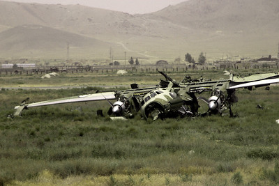 The twisted metal of what appeared to be a helicopter and remnants of destroyed airplanes littered the grassy median along the landing strip - pointed reminders of the ongoing warfare plaguing this ancient civilization.