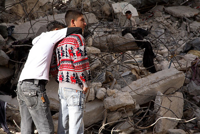 Bethlehem, Palestine 2006 (Panetta)  Young boys stand among the rubble of a house that was demolished by Israeli forces just an hour earlier. When family and friends began throwing rocks at the bulldozer and military tank Israeli soldiers opened fired killing a teenager and leaving an elderly woman brain dead after a bullet struck her in the head.