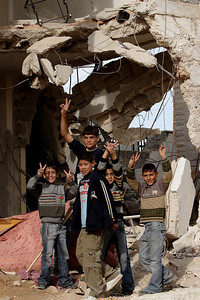 Bethlehem, Palestine 2006 (Panetta)  Palestinian youth stand among the rubble of a house that was demolished by Israeli forces just an hour earlier. When family and friends began throwing rocks at the bulldozer and military tank Israeli soldiers opened fired killing a teenager and leaving an elderly woman brain dead after a bullet struck her in the head.