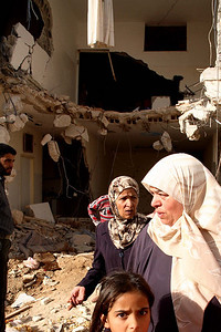 Bethlehem, Palestine 2006 (Panetta)  Family members survey the destruction of their home by Isreali military forces.