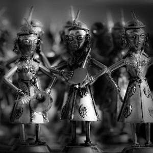 Metal figurines play and sing at an Afghan bazaar.
