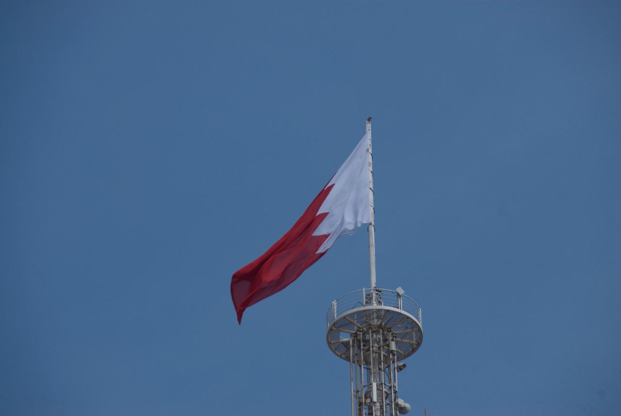 Flag waving over skyline in Bahrain
