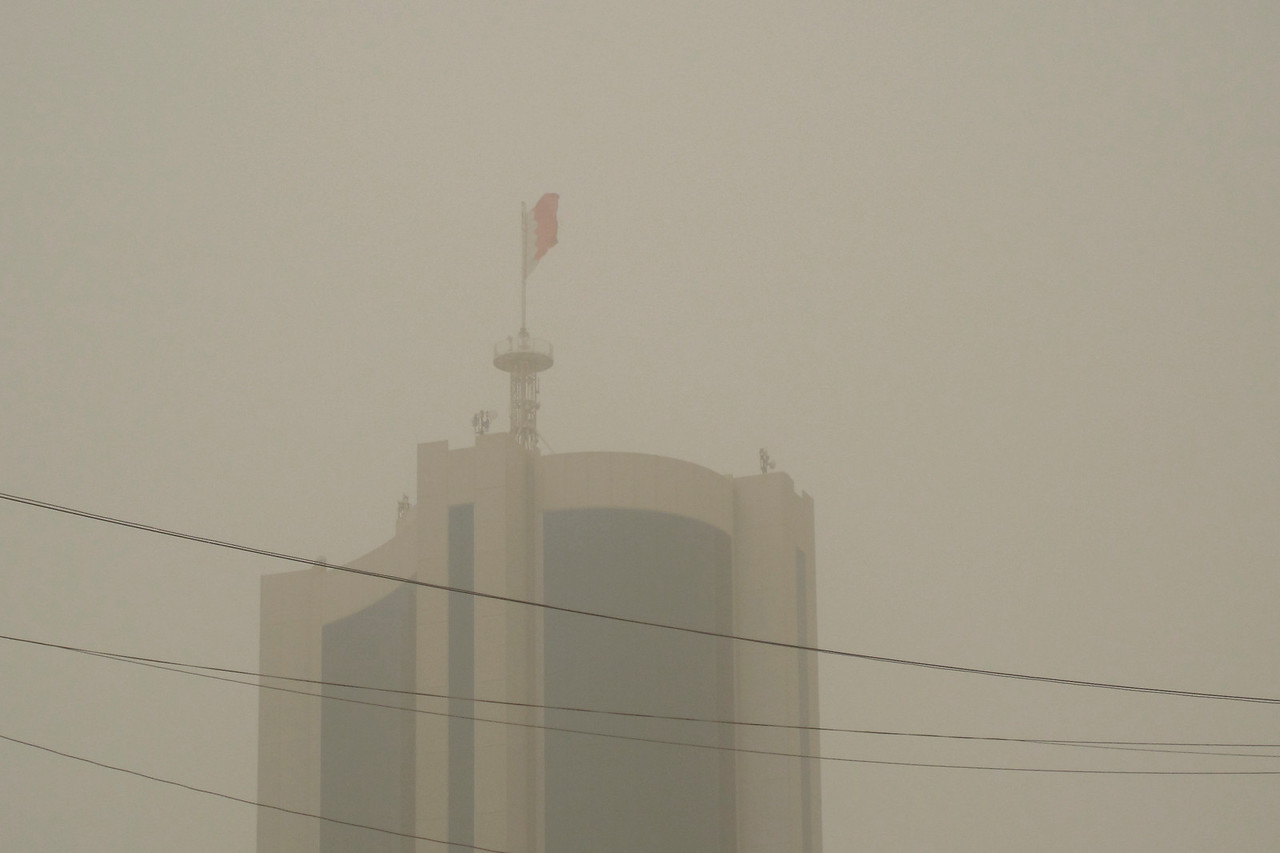 Flag waving amidst sandstorm in Manama, Bahrain