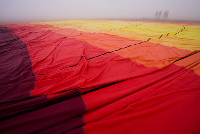 Fog creates a late start to a scheduled balloon ride.