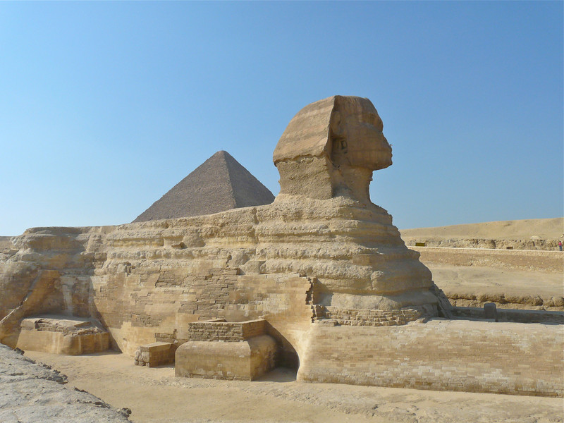 The Sphynx sits in front of the Giza pyramids in Egypt.