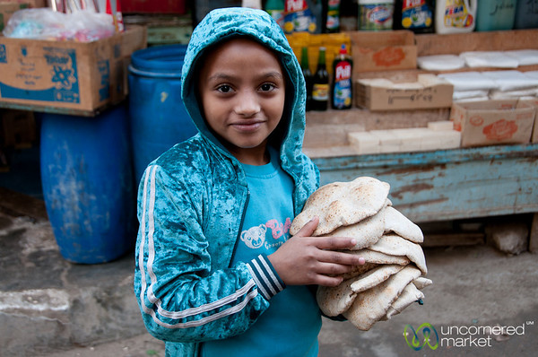 Egyptian Boy with Bread - Alexandria, Egypt