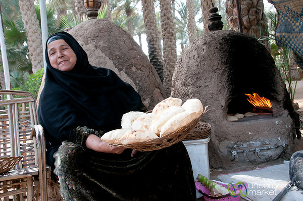 Egyptian woman with Egyptian flatbread