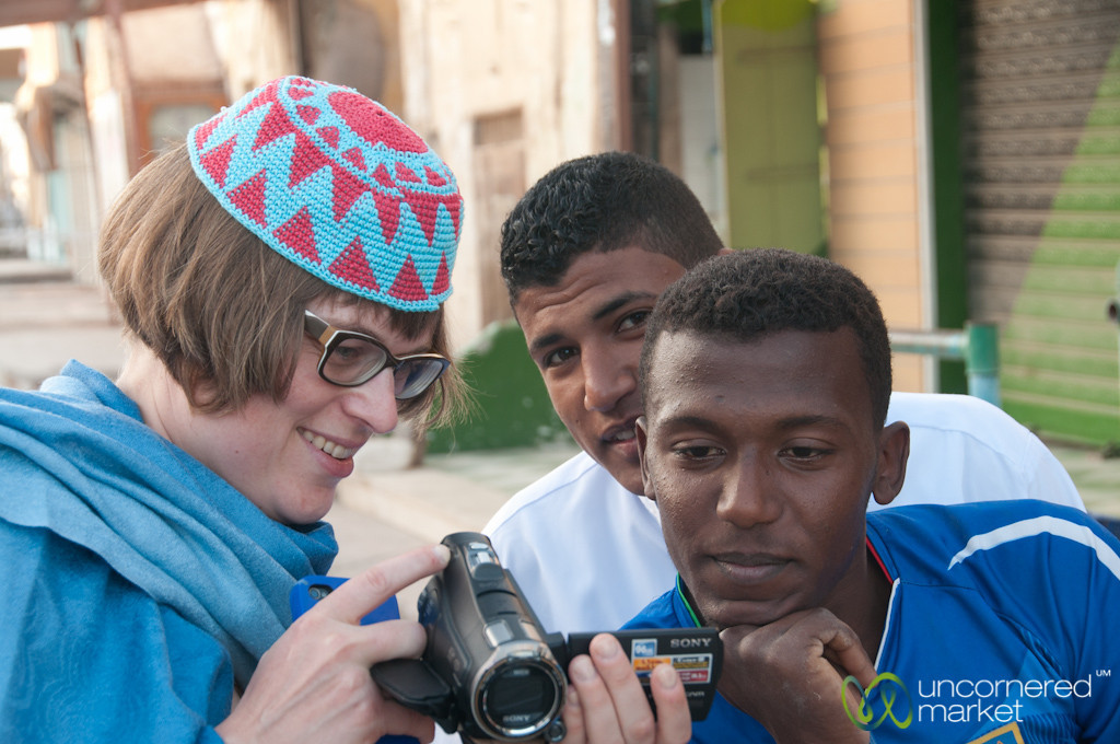 Erica Showing Photos to People - El Quseir, Egypt