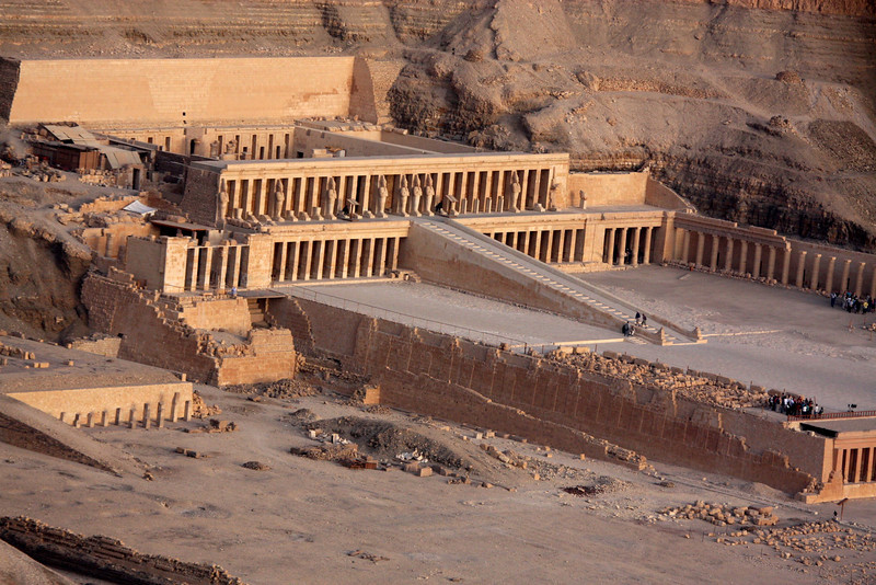 "The focal point of the Deir el-Bahri complex is the Djeser-Djeseru meaning ""the Holy of Holies"", the Mortuary Temple of Hatshepsut. It is a colonnaded structure, which was designed and implemented by Senemut, the royal steward and architect of Hatshepsut (and believed by some to be her lover), to serve for her posthumous worship and to honor the glory of Amun.<br /> <br /> Djeser-Djeseru sits atop a series of colonnaded terraces, reached by long ramps that once were graced with gardens. It is built into a cliff face that rises sharply above it, and is largely considered to be one of the ""incomparable monuments of ancient Egypt. It is 97 feet (30 m) tall ,2007"