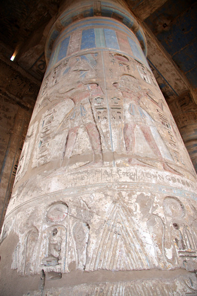 Colorful column at Medinat Habu 2007, The Temple at Medinat Habu is located on the West Bank of the Nile in the ancient city of Thebes, now called Luxor. It's not as large as Karnak Temple, but the colors are better preserved and there are far fewer tourists. It's located next to the sleepy farming village of Kom Lolah. Some travel books name this site as the most overlooked in Luxor