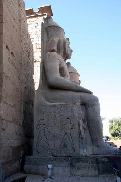 """Six colossal statues of Ramesses II, two of them seated, flanked the entrance, though today only the two seated ones have survived. The one to the east was known as """"Ruler of the Two Lands"""". Luxor, Egypt, 2007"""