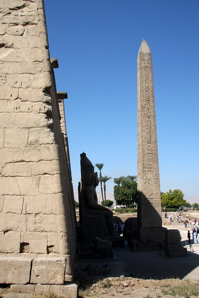 Two red granite obelisks originally stood in front of the first pylon at the rear of the forecourt, but only one, more than 25 meters (75 feet) high, now remains. The other was removed to Paris where it now stands in the center of the Place de la Concorde. Luxor, Egypt, 2007