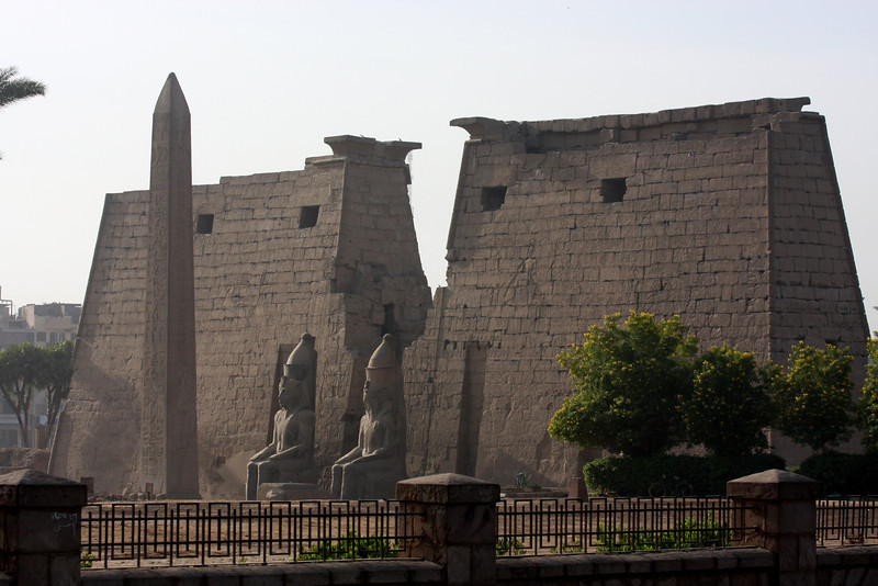 Luxor Temple, in Luxor on the east bank of the Nile, was built around 1400 B.C. the temple was dedicated to the Theban Triad of Gods - Amun, Mut, and Chons. Two red granite obelisks originally stood in front of the first pylon at the rear of the forecourt, but only one, more than 25 meters (75 feet) high, now remains. The other was removed to Paris where it now stands in the center of the Place de la Concorde Luxor, Egypt, 2007
