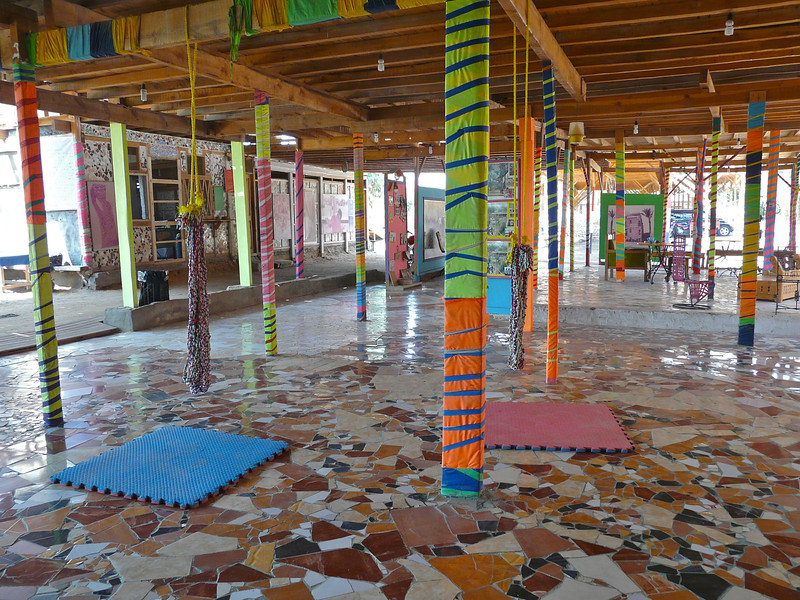 Rope swings hang from colorful supports at Fagnoon Art Center in Cairo, Egypt.