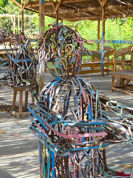 Children paint the wire sculptures over and over again.