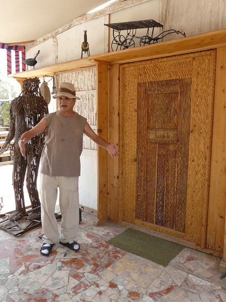 Mohamed Allam talking art in front of a wood-crafted door.