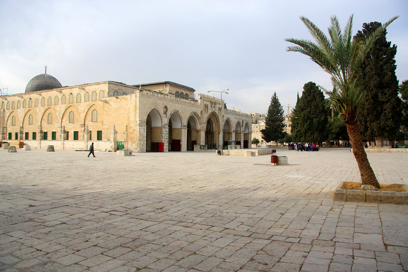"""The Al-Aqsa Mosque ( Arabic: المسجد الاقصى, Masjid Al-Aqsa, literally """"farthest mosque"""") is part of the complex of religious buildings in Jerusalem known as either the Majed Mount or Al-Haram ash-Sharif (the Noble Sanctuary) to Muslims and the Temple Mount to Jews.<br /> <br /> Muslim tradition states that Muhammad ascended to heaven from the Mount in 621, making the mosque the third most holy shrine in Islam (see Isra and Miraj.) After the Dome of the Rock ( 690) the first wooden Al-Aqsa Mosque was constructed by the Umayyads, completed in 710. The structure has been rebuilt at least five times; it was entirely destroyed at least once by earthquakes. The last major rebuild was in 1035.The Al-Aqsa Mosque is the largest mosque in Jerusalem"""
