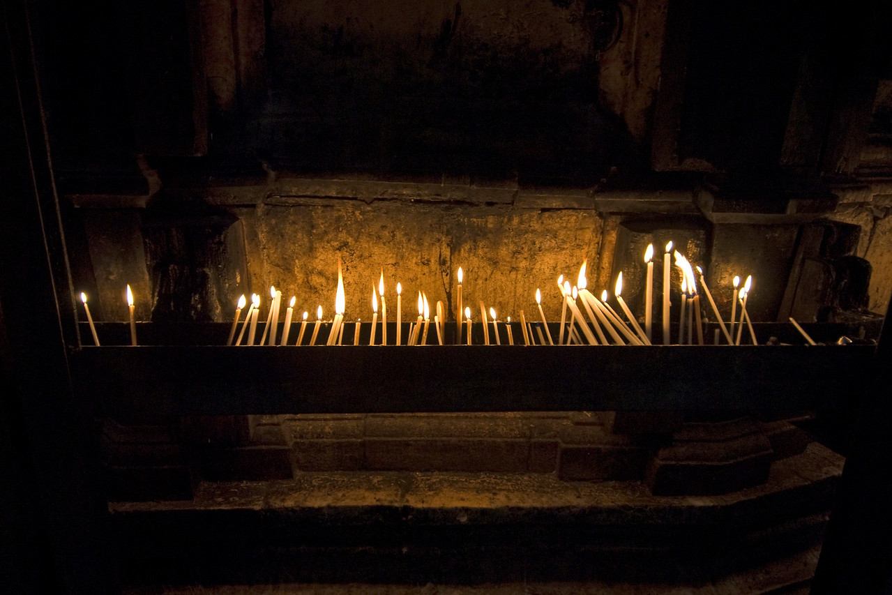 Candles lit at the Church of Holy Sepulchre in Jerusalem, Israel