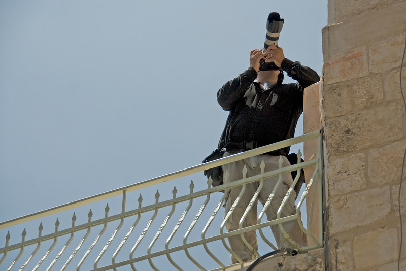 Reporter covering the events of Good Friday in Jerusalem