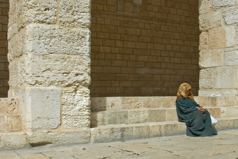 Woman sitting near the Dome of the Rock in Jerusalem, Israel