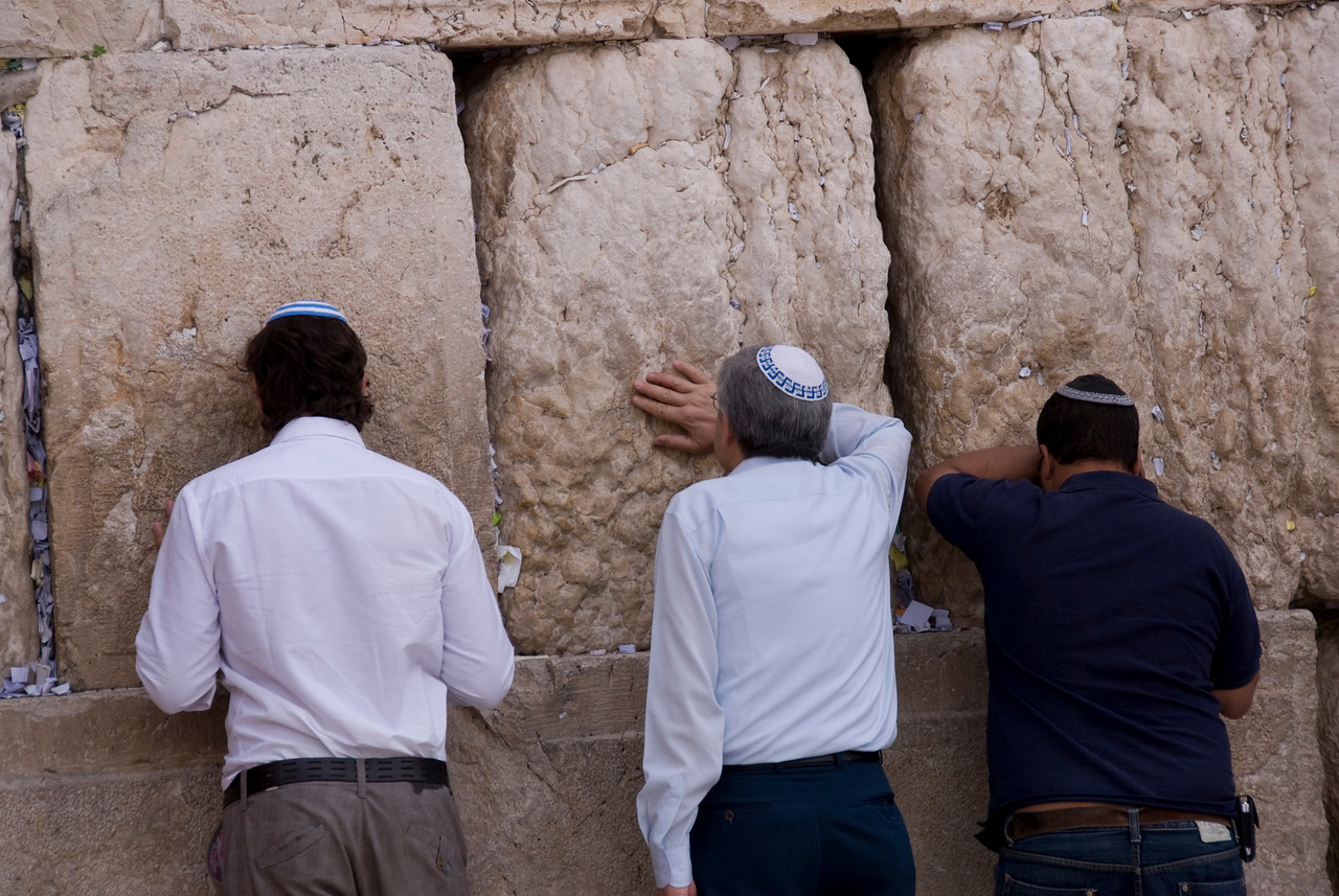 Men praying at the Western Wall in Jerusalem, Israel