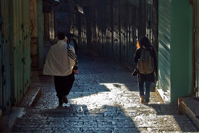 Locals walking a dark alley in Jerusalem, Israel