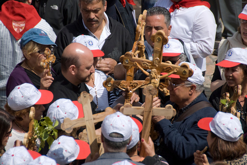 Priests holding cross during Good Friday in Jerusalem