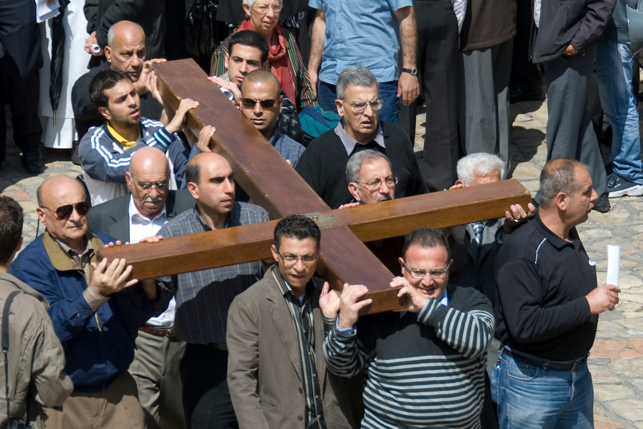 Men carrying the cross outside Church of the Holy Sepulchre in Jerusalem