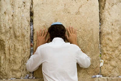 A man praying at the Western Wall - Jerusalem