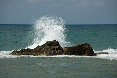 Wave splashing against a rock in the coast of Israel