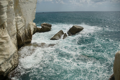 Rocks and white chalk cliff at Rosh HaNikra reserve on Mediterranean sea in Israel