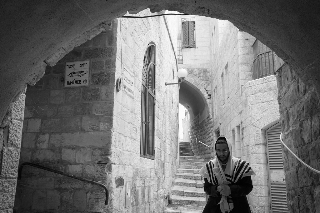 Worshipper heading to the Western Wall through the Jewish Quarter on Shabbat